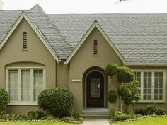 Who said beige has to be boring? This exterior color palette provides a neutral backdrop to the home's lush green landscaping. Paint colors: Grassy Savannah, Ancient Root and Polar Bear by Behr