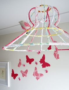 deconstruct an old lamp shade, cover in ribbon or fabric strips. This is adorable& so well done