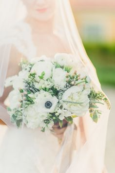 White bridal bouquet with peonies and anemones. Photography: Katie Jackson Photography - www.KatieJacksonPhotography.com