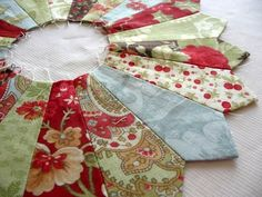 "Bloom: How to cut Dresden plate wedges from 5"" charm squares.  ---------------  Beautiful Quilting work here- TD."