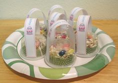 Mini Easter baskets made from plastic portion cups with cut down cup cake liner for basket.  Filled with grass and eggs and then a handle is glued on.