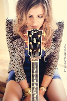 pose with guitar. Could also cut eyes up towards camera. Heather Stewart The Legacy Boutique