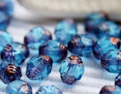 Czech Glass beads Aqua Blue Copper Ends Cathedral faceted oval - 8x6mm - 20Pc - 0109 on Etsy, $4.75