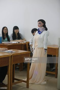 A humanoid robot called Xiao Mei speaks to students in a classroom at Jiujiang University on June 3, 2015 in Jiujiang, China. The robot was created by the university's School of Information Science and Technology in over one month. The robot can give students a lesson following PowerPoint and make simple contact with students.