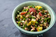 Texas caviar, a dip or salad with black-eyed peas, green onions, cilantro, jalapenos, tomatoes, bell pepper, garlic, olive oil and lime juice.