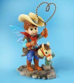 My Little Kitchen Fairies from Enesco Cowboy Fairie Figurine 5.25 IN Enesco http://www.amazon.com/dp/B004QKNMIW/ref=cm_sw_r_pi_dp_bK09vb0231JXN