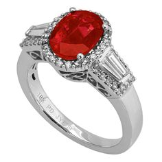 RR24096: A 2.02ct ruby ring set in 18K white gold with 0.32ct G/VS round diamonds and 0.3ct G/VVS baguette diamonds | www.goldcasters.com