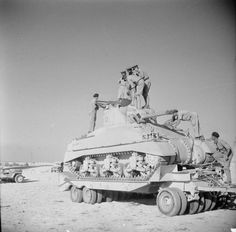 Staff officers examine a newly-arrived Sherman tank sitting on a Scammell Pioneer tank transporter, 15 September 1942.