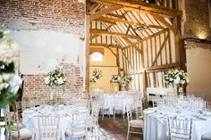 Beautiful Leez Priory Essex wedding venue with floral table decoration by Traditional Vintage Flower Company © Fiona Kelly Photography
