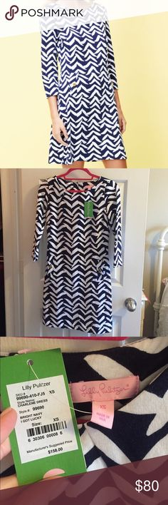 """NWT Lilly Pulitzer Charlene Dress NWT!  Lilly size XS Charlene Dress in """"bright navy I Got Lucky."""" Pretty gold detail on the pockets. Super soft and stretchy (96% cotton, 4% spandex). Priced to sell- make an offer ASAP if you want this amazing dress 😊 Thanks for checking out my listing! Lilly Pulitzer Dresses Long Sleeve"""