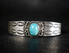 "Old Pawn Navajo Stamped Silver and Turquoise Childs Bracelet or Cuff. Nice heavy 1950s unusal well made bracelet for a young person . Measures 1/2"" tall. Measures 5 "" around the inside including the gap and could be adjusted slightly smaller. Weight 17.7 grams.  by Far Rider West on Etsy"