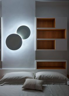 This renovated apartment from the early 20th century in Milan combines contemporary elements with playful volumes to create a welcoming home atmosphere. Project by Silvio Maglione with bedroom featuring the Puck Wall Art collection. Photo: Alberto Ferrero.     http://www.vibia.com/en/puck-wall-art-wall-lights/?utm_source=social&utm_medium=pinterest&utm_campaign=puck_wall_camera_vista_prj&utm_content=utm_term=