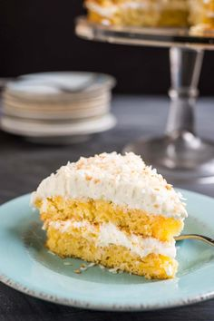 This Pineapple Coconut cake i loaded with fresh pineapple and tastes like a giant pina colada!