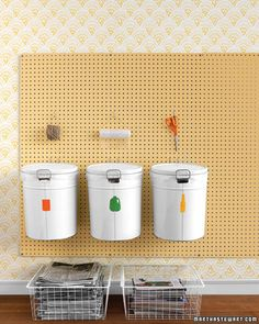 Don't let recycling take over your kitchen. Create a small and efficient recycling station with just a few items from your local craft or hardware store.