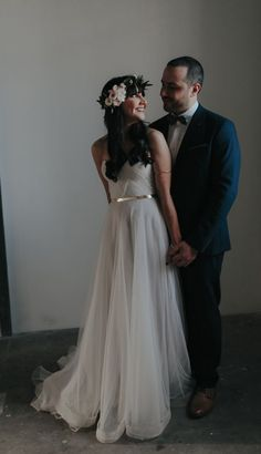 Chic strapless off-white wedding dress with pretty gold belt; Featured Dress: One Day Bridal