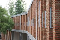 Gallery of Tongjiang Recycled Brick School / Joshua Bolchover - John Lin - 19 Concrete Facade, Concrete Architecture, Facade Architecture, School Architecture, Landscape Architecture, Recycled Brick, Recycled Materials, Brick Fence, Brick Design