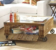 """PB's Woven Crate Coffee Table $700.  35""""x34""""x16""""HT.  It's too short I think but this is about the size we need and square or round - not rectangular like we have now.  This gives texture + you could hide the remotes + junk inside.  Also like that you could just wheel it out of the way to lay on carpet or play a game or clean the carpet.  Yeah for wheels."""