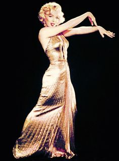 Marilyn Monroe in the iconic gold lamé gown for Gentlemen Prefer Blondes, 1953. Photos by Ed Clark.