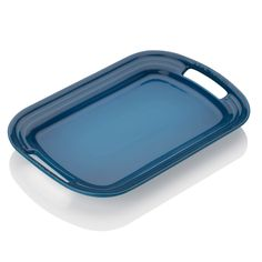Stoneware Small Platter | The stoneware serving platter features ridged edges that slope upward to contain food, while two wide handles are cut into each end to ensure a steady grip when carrying heavier foods like roasts or poultry to the table. Its simple design is finished with an easy-clean, stylish glazed finish.