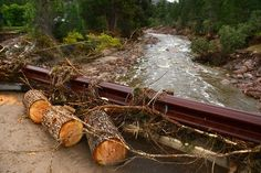 A portion of a bridge left on Cree Court in a neighborhood in Pinewood Springs, Colorado, on September 22, 2103  is packed with debris from ...
