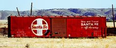 """Santa Fe - All The Way"" ©Darin Volpe - This retired Santa Fe Railway boxcar sits on a ranch in central California. It's 1960's era paint scheme reminds us that before Amtrak was formed in 1970, railroads used their freight cars as traveling billboards for their passenger service. Buy a metal, canvas, acrylic, or standard print, an iPhone/Galaxy case or greeting card of this photo at http://darin-volpe.artistwebsites.com/featured/santa-fe-all-the-way-darin-volpe.html"