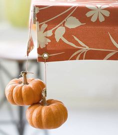 Cute with the pumpkins, but I'm looking at the tablecloth with the grommets to hold the weights...great idea.