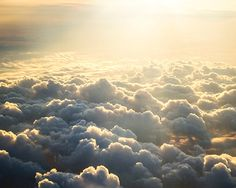 Fine Art Ethereal Print. The suns first light casts a golden glow upon soft, rolling clouds. This is an aerial shot, above the clouds, a powerfully emotional image of hope, awe, and beauty.    Title: Ethereal Hymn  Size: 8x10 in Details:  Photographs are printed on high quality, professional photo paper with a lustre coating to ensure lasting rich color. All photos come unframed and unmatted. Titled, signed, and dated on the back. Carefully packed and shipped to ensure it gets to you…