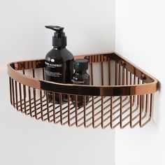 High-quality luxury corner bar basket, ideal for keeping your bottles neat and tidy!  Finished in Rose Gold.