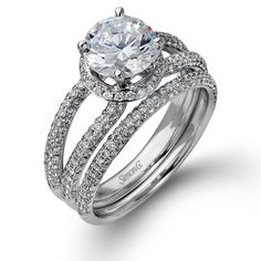 Shimmer Collection - This gorgeous 18K white engagement ring and band is comprised of .78ctw round white Diamonds.  - NR390