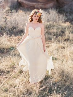 Wedding Gown by @Sarah Chintomby Chintomby Chintomby Seven | See more on Style Me Pretty | http://www.StyleMePretty.com/2014/03/14/southwest-desert-bridal-inspiration/ Photography: Ashley Sawtelle