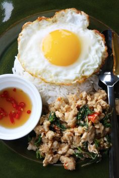 Spicy Thai recipe: Pad Ka-Prao - a spicy basil stir fry with minced pork served with an egg on top.