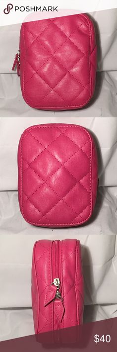 Pink Trish McEvoy Vegan Leather Quilted Planner Pink Trish McEvoy Vegan Leather Quilted Planner  Trish McAvoy petite pink quilted vegan leather planner. 4.25 inches wide, 6 inches tall, 2.5 inches deep. Zip closure,  Silver gray nylon interior, with four brush pockets, and one pouch. Two ring binder for Trish inserts. Excellent gently used condition, no blemishes, scuffs, or marks trish mcevoy Bags Cosmetic Bags & Cases