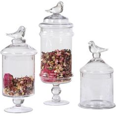 Glass Containers with Bird Finials ~ I use glass for everything.  Mason jars in the pantry, fancy on counters & shelves.