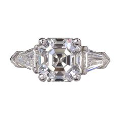 Peter Suchy Asscher Diamond Engagement Ring Platinum Bullet Cut Side Diamond | From a unique collection of vintage more rings at https://www.1stdibs.com/jewelry/rings/more-rings/