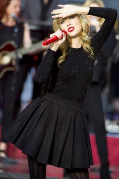 Love TSwift's Outfit. I love the sparkles on the long sleeve :)