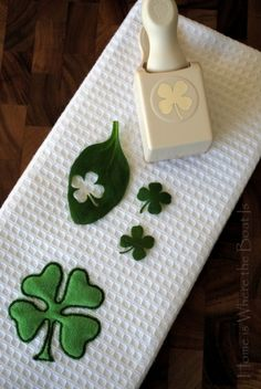 What a cute idea! Punch some shamrocks from baby spinach or basil and decorate your St Patty's Day food!