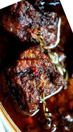 Braised Beef Short Ribs _ Seriously. Leesten. You must make this as soon as you can. Beef short ribs are like the most flavorful, delectable, tender, soft pot roast you can possibly imagine. The meat falls off the bone if you so much as breathe on it. Oh, is it ever a treat.