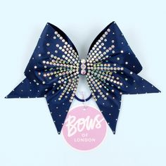 Navy bow with starburst AB crystals.This bow is made to order.