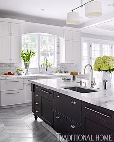 Stylish Tone-on-Tone Kitchen | Traditional Home magazine. Top Knobs cup pulls used as cabinet hardware.