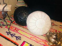 Items similar to 2 set of Moroccan traditional Berber leather pouf a black pouf & a white pouf Moroccan pouf leather pouf, pouf ottoman bohemian pouf natural on Etsy Moroccan Leather Pouf, Moroccan Pouf, Moroccan Style, Crochet Pouf, Knitted Pouf, Leather Ottoman, Pouf Ottoman, Living Room Pouf, 2 Set