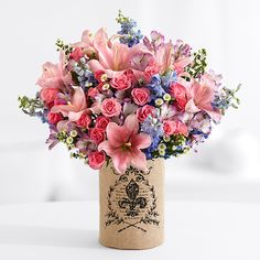 Do you know a mom who is très chic? The fleur-des-lis design on this burlap-wrapped vase is everything she wants.