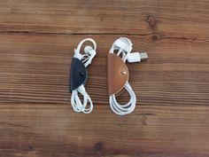 """Leather Cord Wrap - Cord Taco """"Clean up your messy cords. Easily wrap your earbuds, USB cables and other small wires in the convenient envelope-like case."""""""