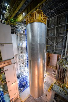 A qualification test article for the tank on the SLS is lifted off the Vertical…