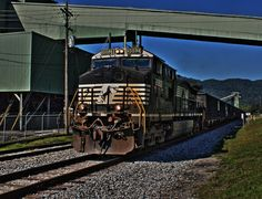Mining & Moving Coal: A loaded coal train passes a coal preparation plant complex on former Conrail West Virginia Secondary line in Fayette County, West Virginia