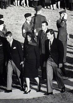 Burying a president......Bobby, Jackie and Teddy. Clint Hill (Jackie's SS) slightly behind.