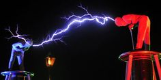The British performance duo 'Lords of Lightning' bow their heads and allow a 4 million volt tendril of electricity to arc between them during the Rock for People music festival in Hradec Kralove, Czech Republic, on July Comedy Acts, July 5th, Talent Agency, Corporate Events, The Rock, The Magicians, Acting, Neon Signs, Animation