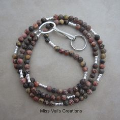Leopardskin jasper lanyard. This stone has fantastic markings! Use to wear and ID badge, keys, transportation pass and more.