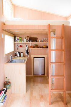 Tiny house: Small-space living (She built her home atop a 15-foot-trailer. See the beautiful results.)