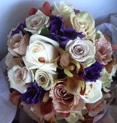 BG124 Purple lisianthus, brown vanda orchids, latte `Julia` roses, mushroom `Creme de Menthe` roses, `Sahara` roses and cream `Vendella` roses