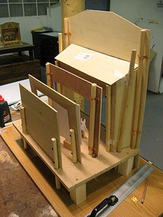 Puppet theater with layered scenery. Supports on the back of each layer